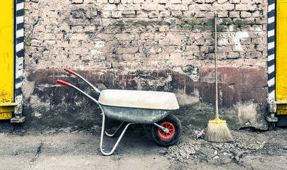hand cart near old wall