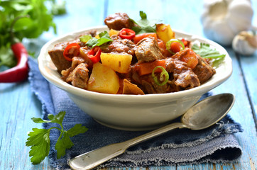 Meat stewed with vegetable in spicy tomato sauce.