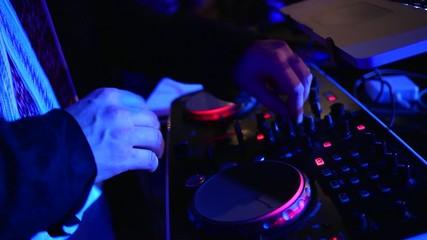 DJ mixes tracks at the disco