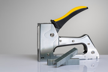 Furniture stapler on white background