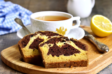 Pumpkin and chocolate cake with cup of tea.