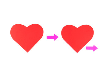 Two red paper hearts with arrows, concept relationships
