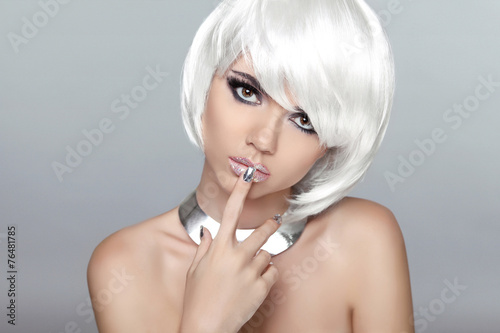 Aluminium Beautiful blond young woman with polish finger. Makeup. Manicure