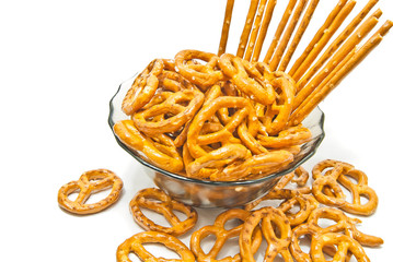 tasty breadsticks and pretzels on a plate