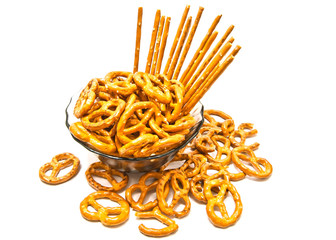 breadsticks and pretzels on a plate closeup