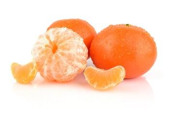 Studio shot dewy peeled mandarines isolated on white