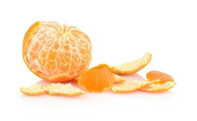 Single peeled mandarine with rind isolated on white