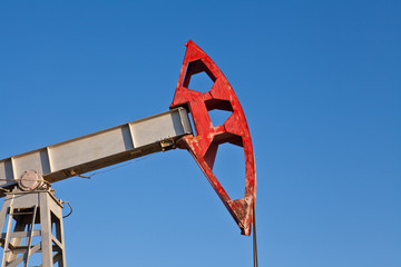 part of the oil pump closeup on blue sky background