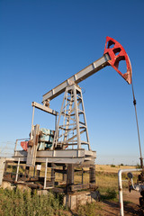 Oil pump on a background of blue sky