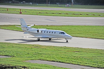 An executive Jet taxiing up to Echo at Gatwick Airport London