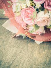 Rose bouquet on wooden floor