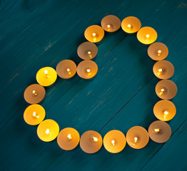 The heart of the candles on a blue background