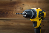 electric drill on a wooden background