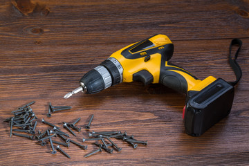 electric screwdriver on a wooden background