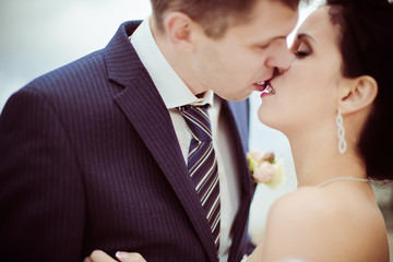 Happy bride and groom on their wedding. High key blurred image