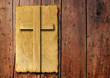Old vintage Christian paper cross on wood