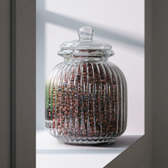 Retro or vintage glass jar full of coffee beans on the window