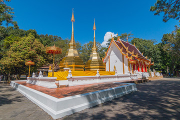 Twin golden pagoda and Buddhist church at Wat Phra That Doi Tung