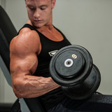 Hnadsome young man working out with dumbbells in fitness -  powe