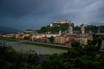 Salzburg r with dramatic cloudscape during blue hour, Austria