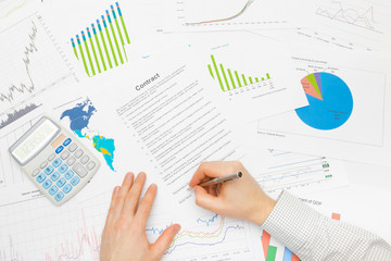Business man working with financial data - signing contract