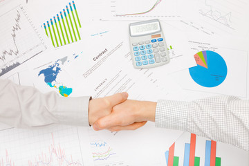 Working with financial data - shaking hands over contract