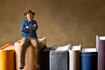 man sitting on the books