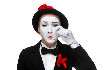 Portrait of thesad and crying mime