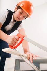 boy sawing board