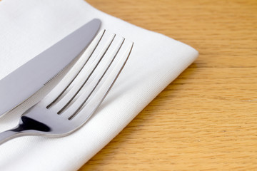 Knife and fork on a white napkin