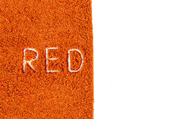 The word red written in pepper powder background