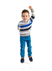 Kid jumping over white background
