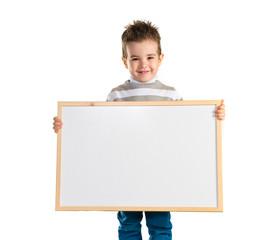 Kid holding empty placard