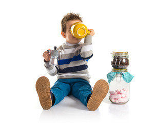 Kid holding a cup of coffee