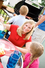 Summer: Mother At Dinner Table with Family Around