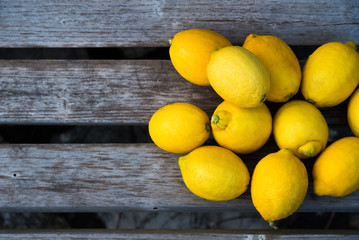 Yellow lemons on old wooden brunch