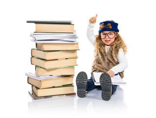 Student little girl sitting around books