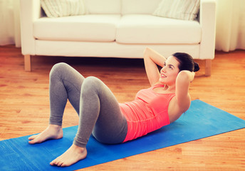 smiling girl doing exercise on floor at home