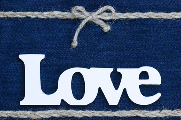 Wood Love text with rope border on denim background