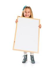 Little blonde girl holding an empty placard