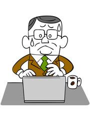 ノートパソコンを使う年輩のビジネスマン_焦り