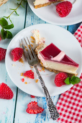 Raspberry cake with fresh fruits on rustic table