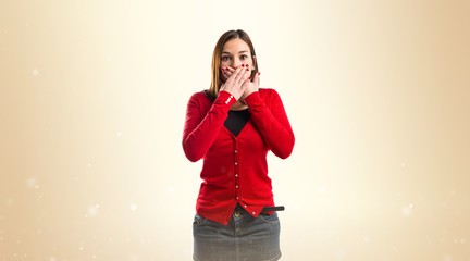 Woman with her mouth closed by her hands