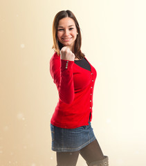 Successful young pretty woman over white background