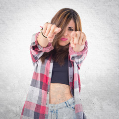 Girl pointing to the front over white background