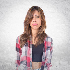 Sad girl over isolated white background