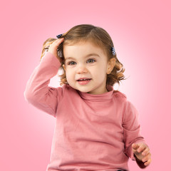Little girl over pink background