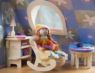 doll in a chair