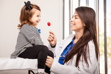 Pediatrician giving a lollipop