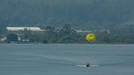 Parasailing over lake Rotorua New Zealand